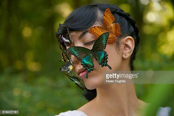 portrait of woman with butterflies on her face