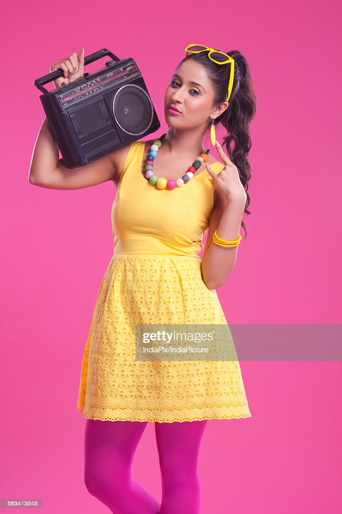 Portrait of woman with cassette player : Stock Photo