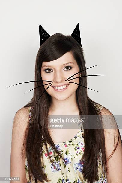 portrait of woman with cat ears and whiskers - moustaches animales photos et images de collection