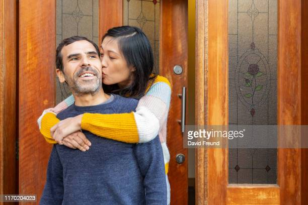 portrait of woman with cerebral palsy with her partner - david freund stock pictures, royalty-free photos & images