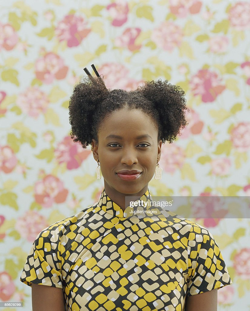 Portrait of woman with chopsticks in hair : Stock-Foto