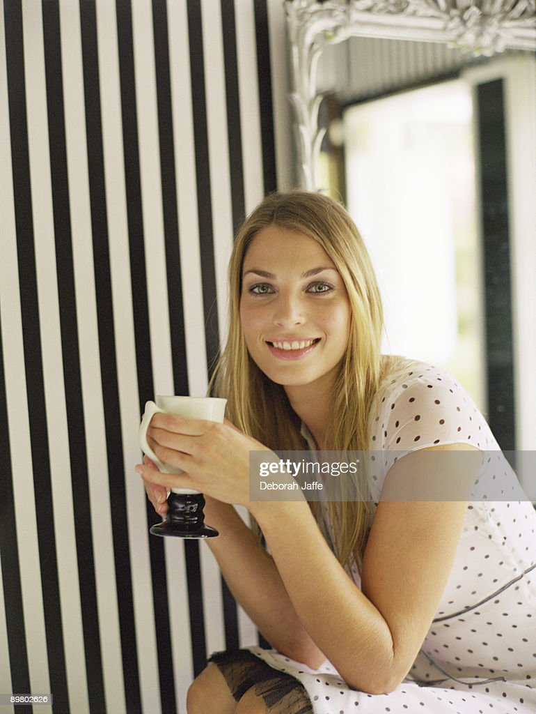 Portrait of woman with coffee cup : Foto de stock