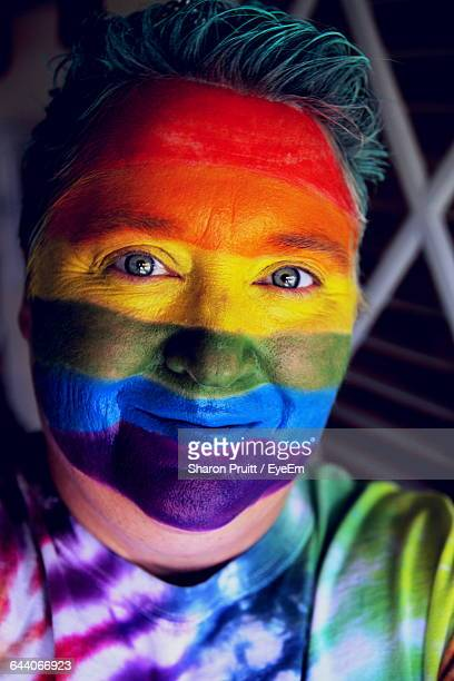 Portrait Of Woman With Colorful Face Paint