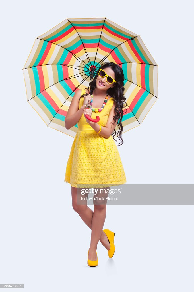 Portrait of woman with colourful umbrella : Stock Photo