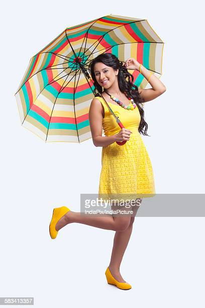 Portrait of woman with colourful umbrella