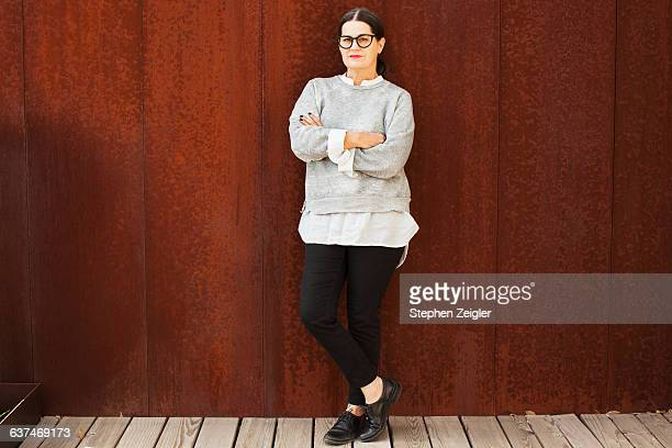portrait of woman with crossed arms - full length stock pictures, royalty-free photos & images