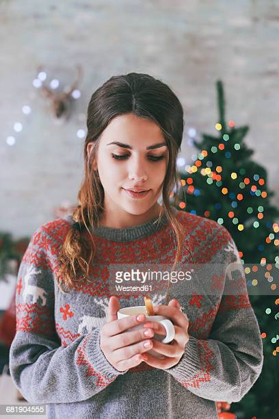 Portrait of woman with cup of coffee at Christmas time