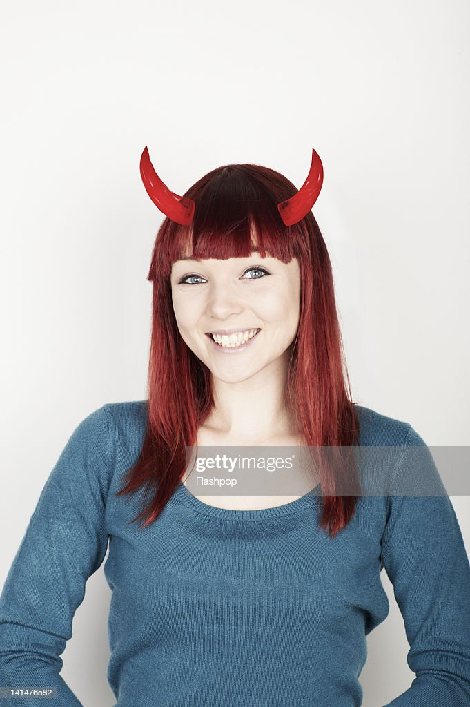 Portrait of woman with devil horns : Stock Photo
