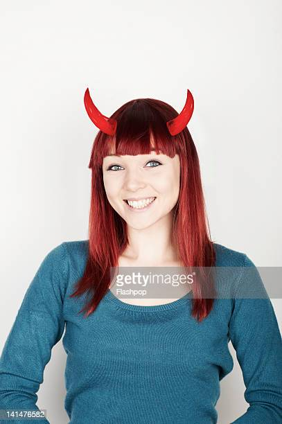 portrait of woman with devil horns - devil costume stock photos and pictures