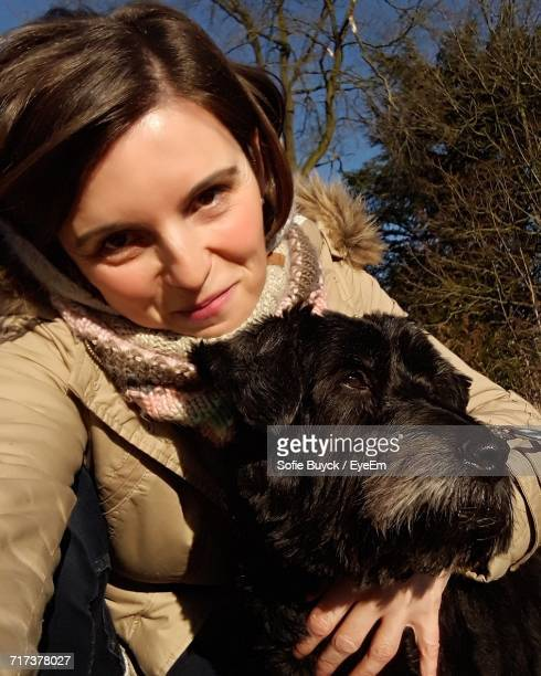 portrait of woman with dog on sunny day - black hairy women stock pictures, royalty-free photos & images