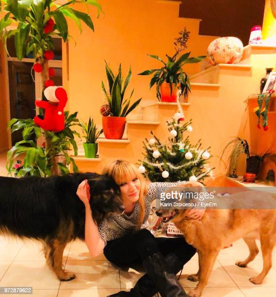 Portrait Of Woman With Dogs At Home During Christmas Celebration
