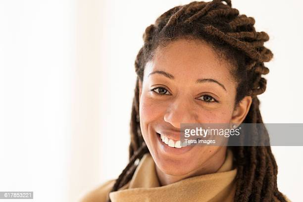portrait of woman with dreadlocks on white background - ドレッドロック ストックフォトと画像