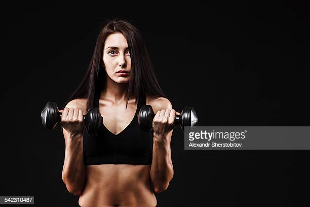Portrait of woman with dumbbells