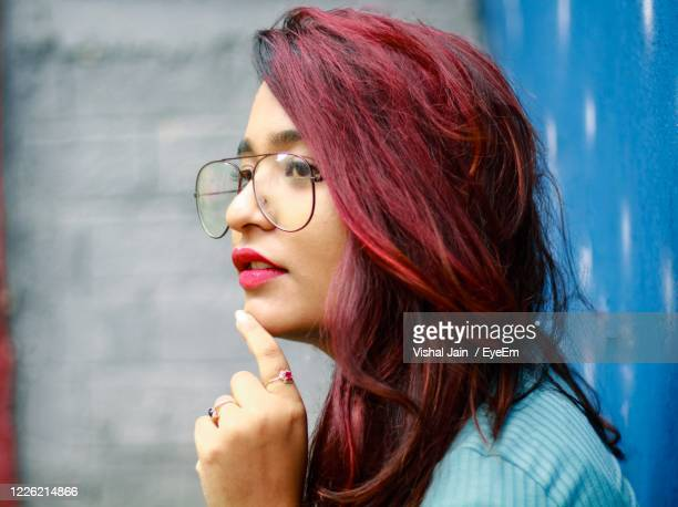 portrait of woman with eyeglasses - dyed red hair stock pictures, royalty-free photos & images