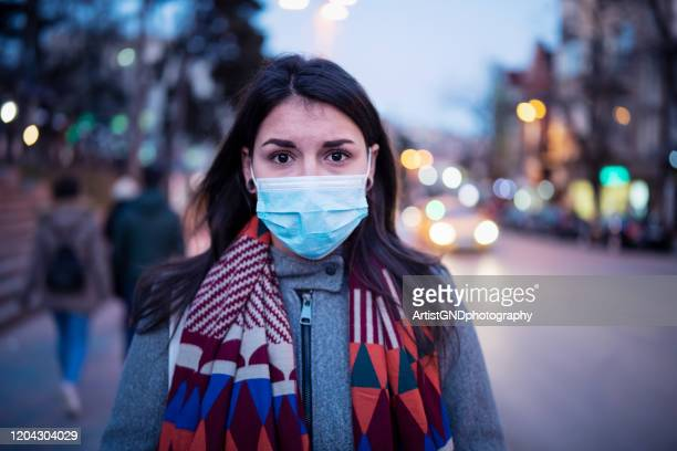 portrait of woman with face mask. - pandemic illness stock pictures, royalty-free photos & images