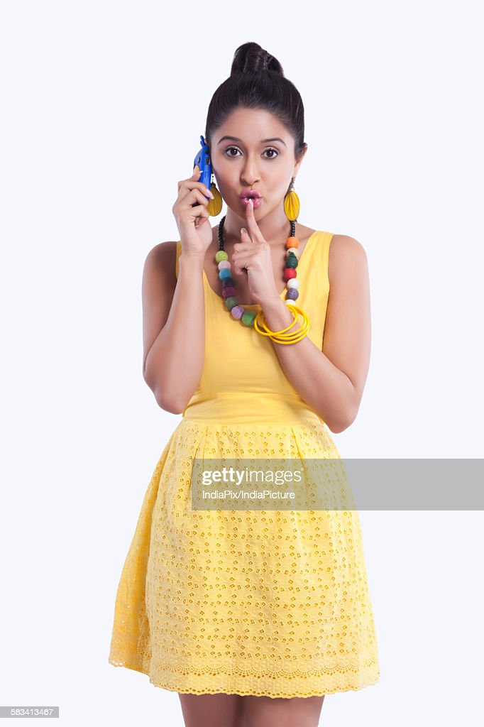 Portrait of woman with finger on lips : Stock Photo