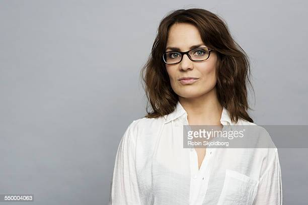 portrait of woman with glasses in white shirt - 35 39 years stock pictures, royalty-free photos & images