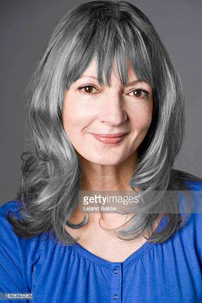portrait of woman with grey hair smiling