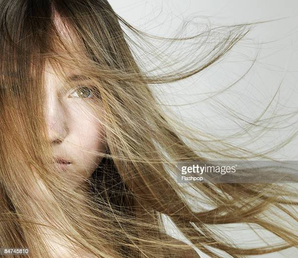 Portrait of woman with hair blowing in the wind