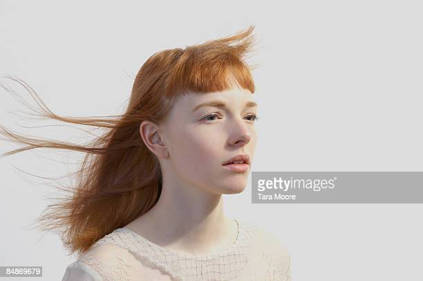 portrait of woman with hair blowing in wind