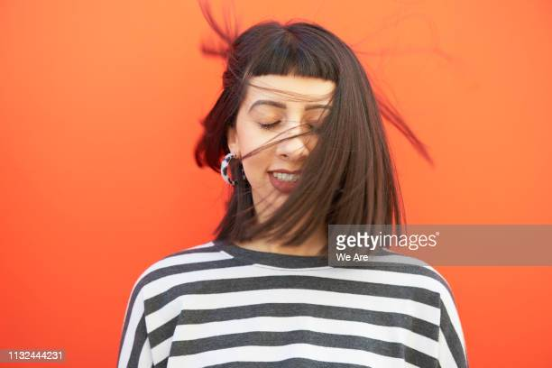 portrait of woman with hair sweeping over face. - eyes closed stock pictures, royalty-free photos & images