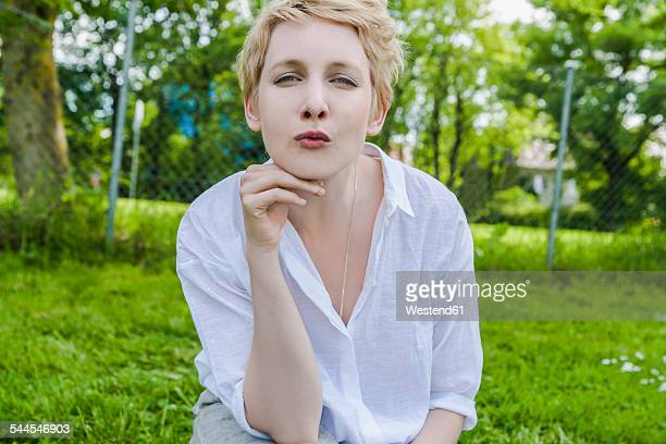Portrait of woman with kissing lips