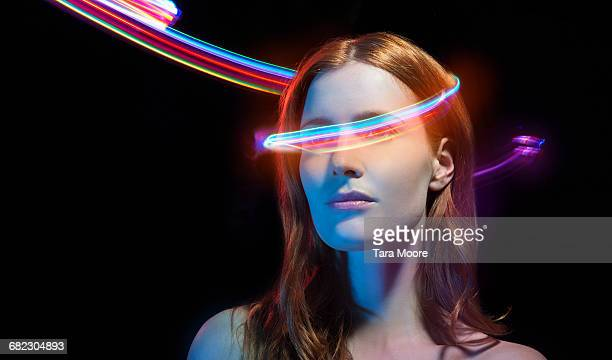portrait of woman with light trails - digital composite stock pictures, royalty-free photos & images