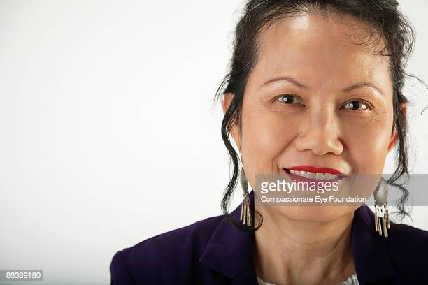 portrait of woman with lipstick and long earrings