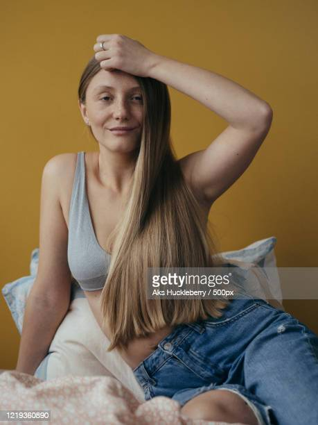 portrait of woman with long blond hair in her bedroom, russia - showus stock pictures, royalty-free photos & images