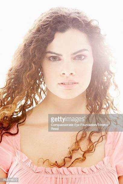 portrait of woman with long brown hair - compassionate eye foundation stock pictures, royalty-free photos & images