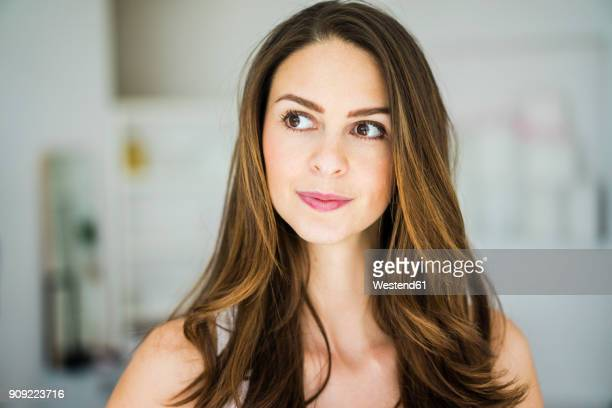 portrait of woman with long brown hair - brown eyes stock pictures, royalty-free photos & images
