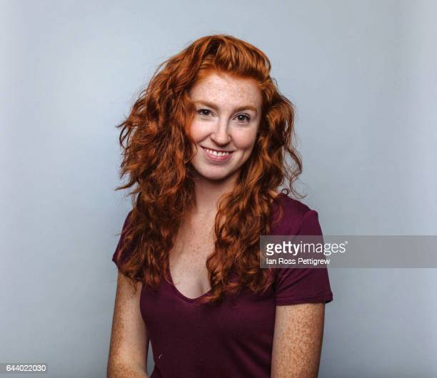 Portrait of woman with long red hair and freckles