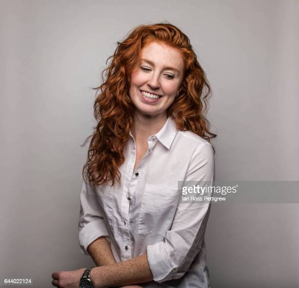 portrait of woman with long red hair and freckles - dyed red hair stock pictures, royalty-free photos & images