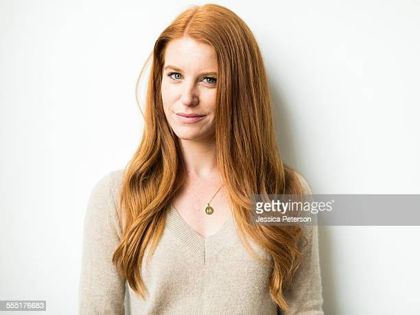 Portrait of woman with long red hair