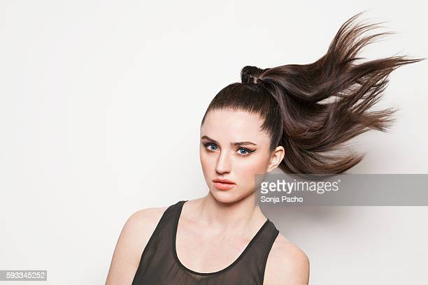 portrait of woman with ponytail - hair back stock pictures, royalty-free photos & images