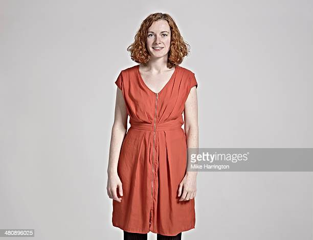 portrait of woman with red hair smiling to camera. - red dress stock pictures, royalty-free photos & images