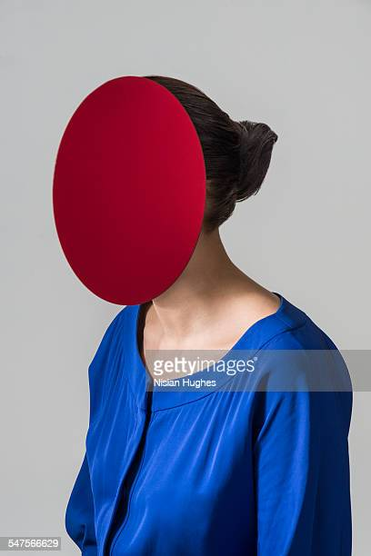 Portrait of woman with red oval over her face