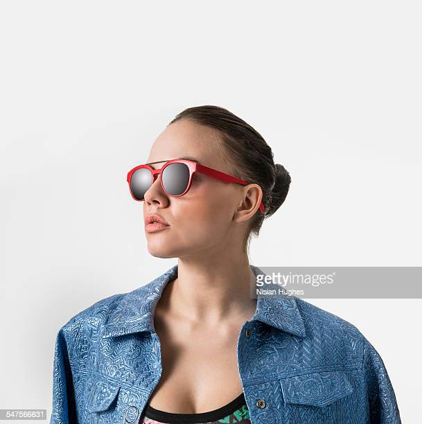 Portrait of woman with red sunglasses on