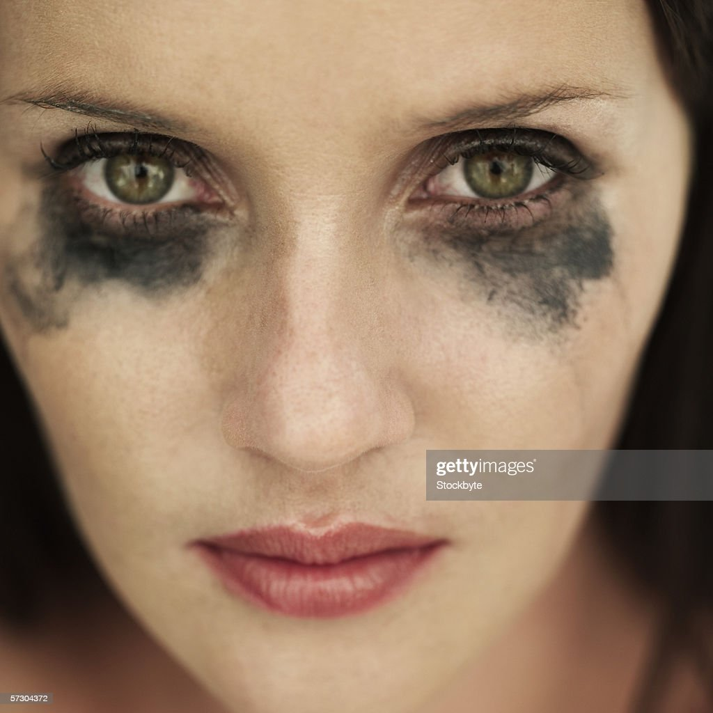 Portrait of woman with running eye mascara : Stock Photo