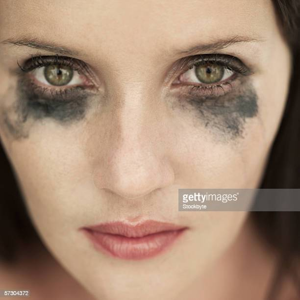 Portrait of woman with running eye mascara