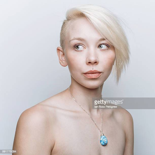 Portrait of woman with short blonde hair