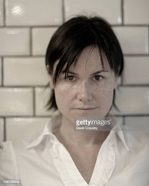 portrait of woman with short dark hair - crausby stock pictures, royalty-free photos & images