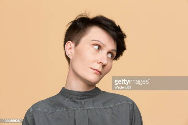 portrait of woman with short hair - head cocked stock pictures, royalty-free photos & images