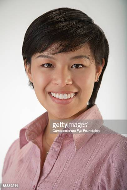 "portrait of woman with short hair smiling - ""compassionate eye"" stock-fotos und bilder"