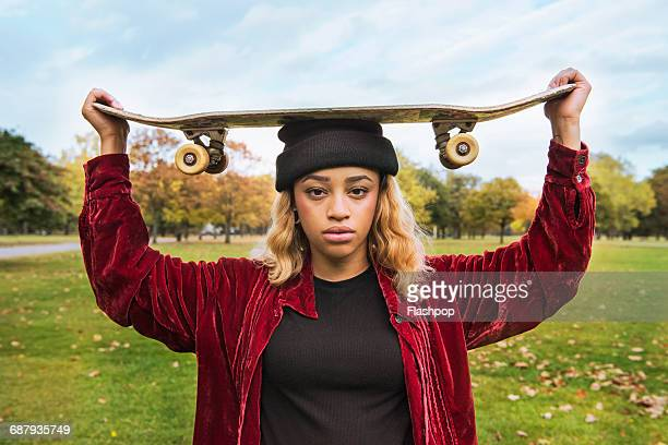 Portrait of woman with skateboard