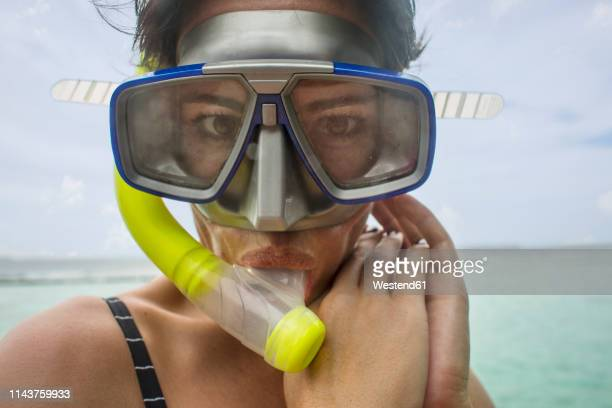 portrait of woman with snorkel and diving goggles - scuba mask stock pictures, royalty-free photos & images