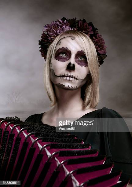 portrait of woman with sugar skull makeup and accordion - accordionist stock pictures, royalty-free photos & images