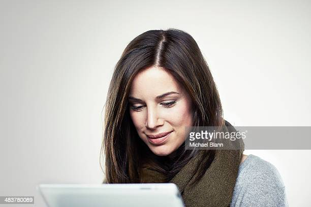 Portrait of woman with tablet