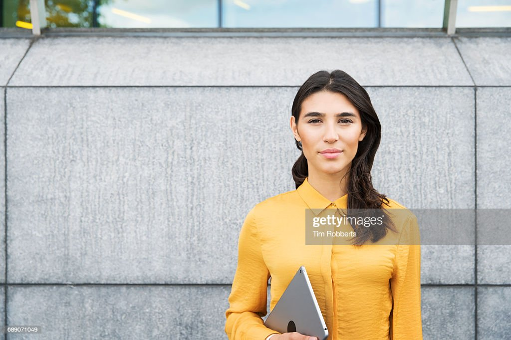 Portrait of woman with tablet : Stock Photo