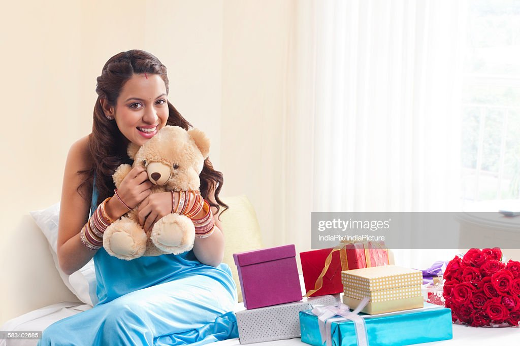 Portrait of woman with teddy bear : Stock Photo